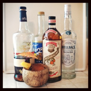 A traditional Mai Tai and its ingredients